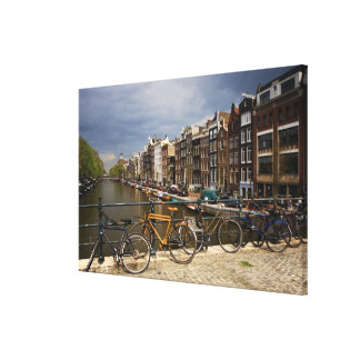 Netherlands, Amsterdam. View of canal from Canvas Print