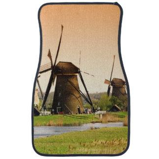 Netherlands, Kinderdijk. Windmills next to Car Mat