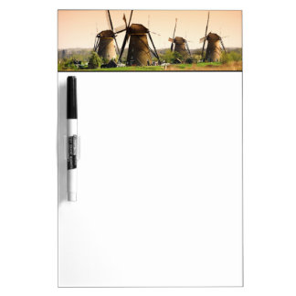 Netherlands, Kinderdijk. Windmills next to Dry Erase Board