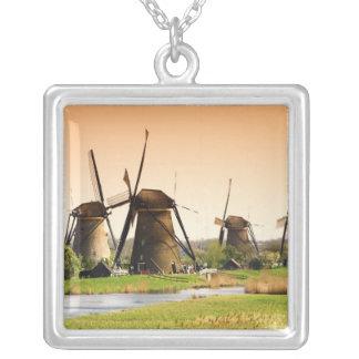 Netherlands, Kinderdijk. Windmills next to Silver Plated Necklace