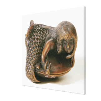 Netsuke carved in the shape of a mermaid canvas print