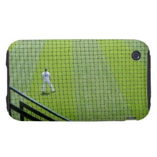 Netting with baseball player on green grass. tough iPhone 3 cases