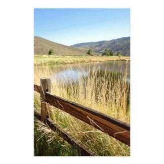 Nevada landscape with wood fence, lake, sky. stationery design