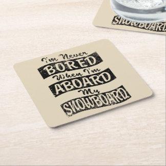 Never Bored ABOARD my SNOWBOARD (Blk) Square Paper Coaster