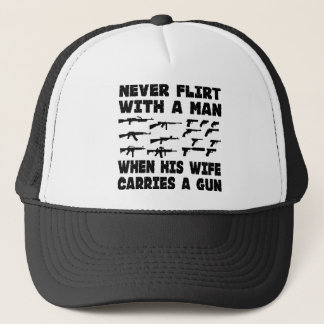 Never Flirt With A Man When His Wife Carries A Gun Trucker Hat