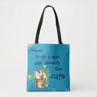 Never trust a man who doesn't like cats tote bag