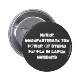 Never underestimate 6 cm round badge