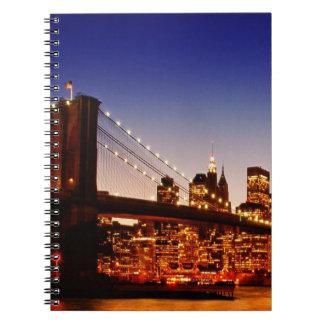 New York cityscape with bridge over river Note Book