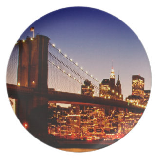 New York cityscape with bridge over river Plate