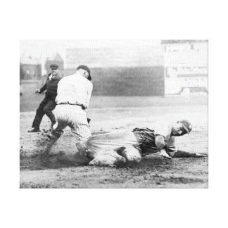New York Yankee player slides into Base Canvas Print