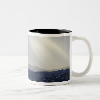 New Zealand, Otago, Dunedin, Light Shafts over Two-Tone Coffee Mug