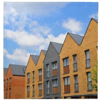 Newly built houses against blue sky napkin