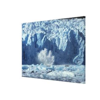 Newly-calved iceberg splashing into chilly canvas print