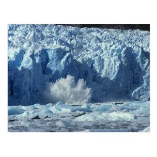 Newly-calved iceberg splashing into chilly postcard