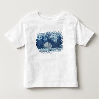 Newly-calved iceberg splashing into chilly tee shirts