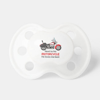 NEXT TO HIS MOTORDYCLE BABY PACIFIER