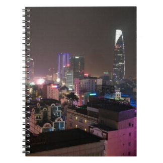 Night time cityscape of Ho Chi Minh City. Notebook