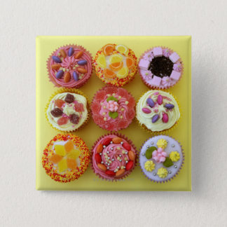 Nine cupcakes each decorated with candy in a 15 cm square badge
