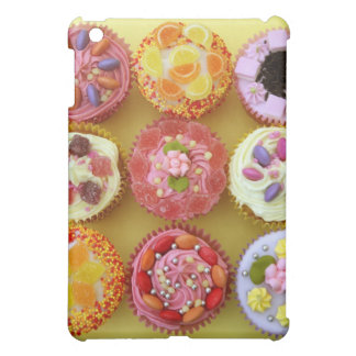 Nine cupcakes each decorated with candy in a iPad mini cover