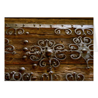 Norman iron scroll work on wooden door card
