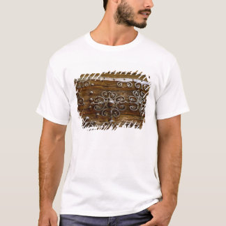 Norman iron scroll work on wooden door T-Shirt
