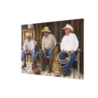 North America, USA. Cowboys relaxing and Canvas Print