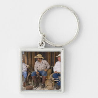 North America, USA. Cowboys relaxing and Silver-Colored Square Key Ring