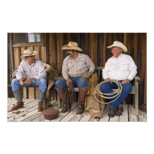 North America, USA. Cowboys relaxing and Photograph