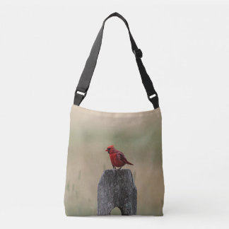Northern cardinal stands on a fence post tote bag