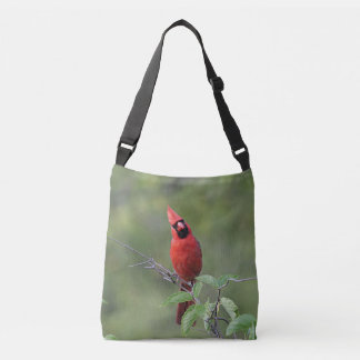 Northern cardinal stands on a tree branch tote bag