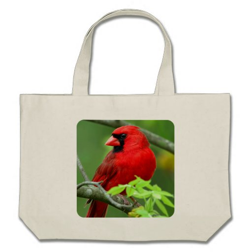 Northern cardinals tote bags