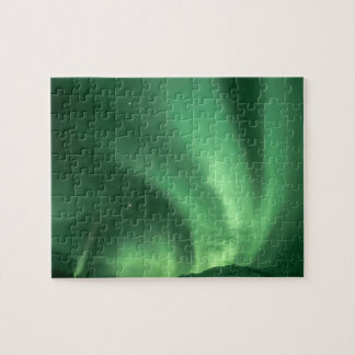 Northern lights, Aurora borealis, over foothills Jigsaw Puzzle