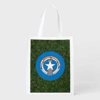 Northern Mariana Islands Flag on Grass