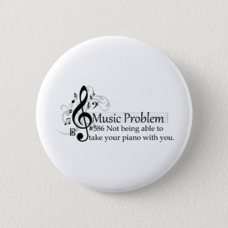 Not being able to take your piano with you. 6 cm round badge