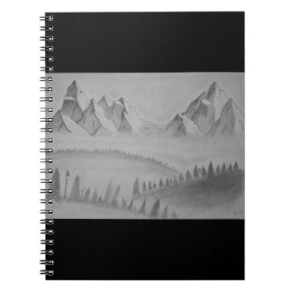 Notebook with mountains in the mist