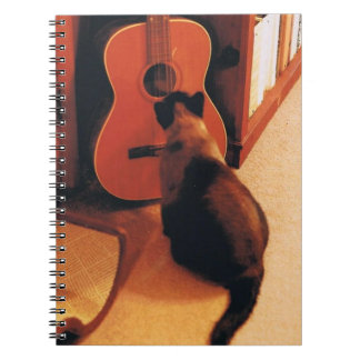Notebook with Siamese Cat
