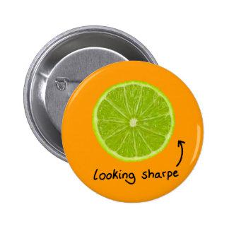 "novelty ""looking sharpe"" lime badge"