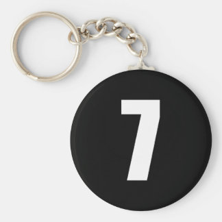 number 7 in white on black button keychain