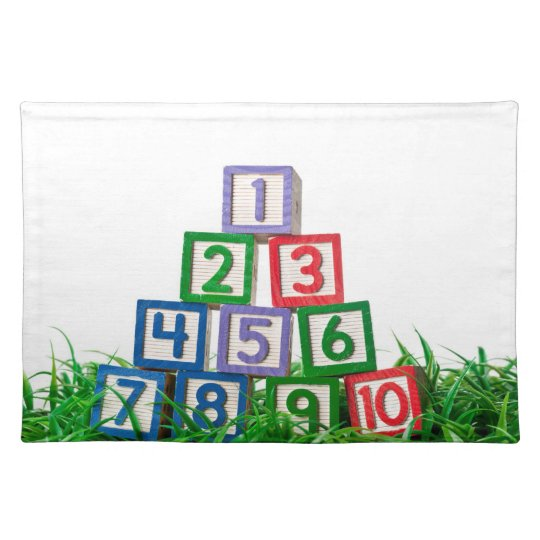 Number blocks stacked on grass place mat