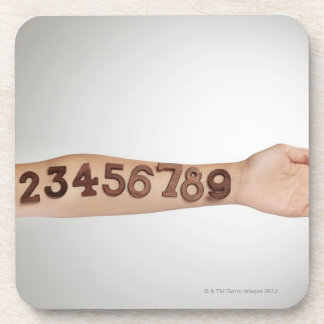 numbers affixed to the arm,ands close-up coaster