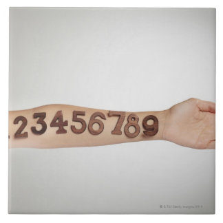 numbers affixed to the arm,ands close-up tile