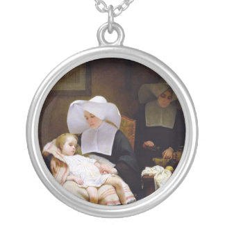 Nun caring for a sick child round pendant necklace