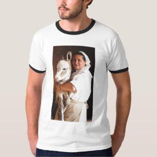 Nun holding her Donkey shirt