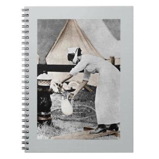 Nurse at Water Pump WWI Spiral Notebooks