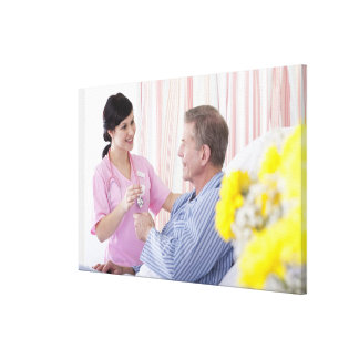 Nurse giving patient medication in hospital canvas print
