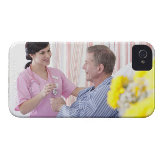 Nurse giving patient medication in hospital iPhone 4 Case-Mate cases