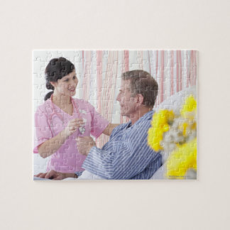 Nurse giving patient medication in hospital jigsaw puzzle