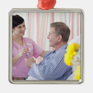 Nurse giving patient medication in hospital Silver-Colored square decoration