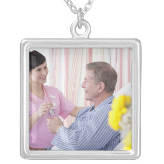Nurse giving patient medication in hospital silver plated necklace