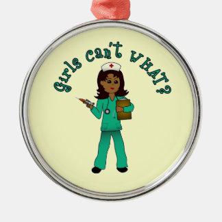 Nurse in Green Scrubs (Dark) Round Metal Christmas Ornament